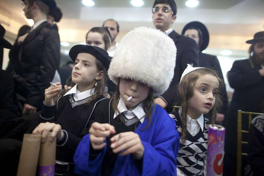 Preteen puffers: Jewish boys light up while attending an ultra-orthodox wedding in the Mea Shearim neighborhood of Jerusalem, Israel. It's apparently normal for boys to have a cigarette, like their fathers, at such celebrations. Photo: Lior Mizrahi, Getty Images