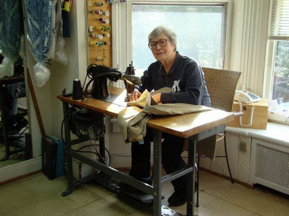 Raffaella Sforza is closing Aldo and Rafaella Tailor Shop, which she founded in Westport with her late husband 40 years ago. She is seen here working at her Singer sewing machine. Photo: Contributed Photo / Westport News