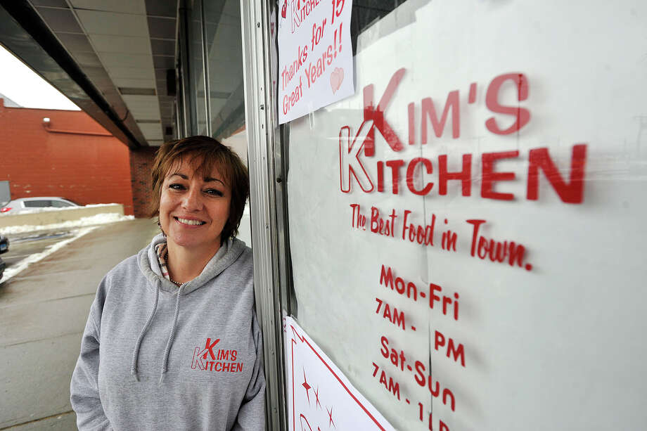 Kim Santagata, former owner of Kim's Kitchen, poses in front of her restaurant in the Springdale neighborhood of Stamford, Conn., on Wednesday, Feb. 19, 2014. Santagata closed up shop after 15 years in the restaurant business. She plans to travel throughout the country with her husband, who she married in her restaurant nearly two years ago. Photo: Jason Rearick / Stamford Advocate