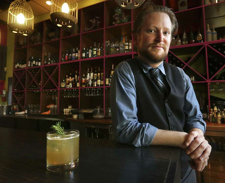 Josh Finnie is the bartender at the new Umai Mi, which replaced Bin 555, where he also tended bar. Photo: Bob Owen / San Antonio Express-News / ©2013 San Antonio Express-News