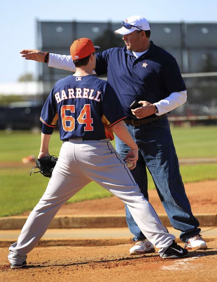 Roger Clemens talks with Lucas Harrell during pitcher and catcher workouts. Photo: Karen Warren, Houston Chronicle