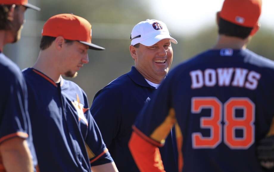 Roger Clemens talks with pitchers before the start of workouts on Wednesday. Photo: Karen Warren, Houston Chronicle