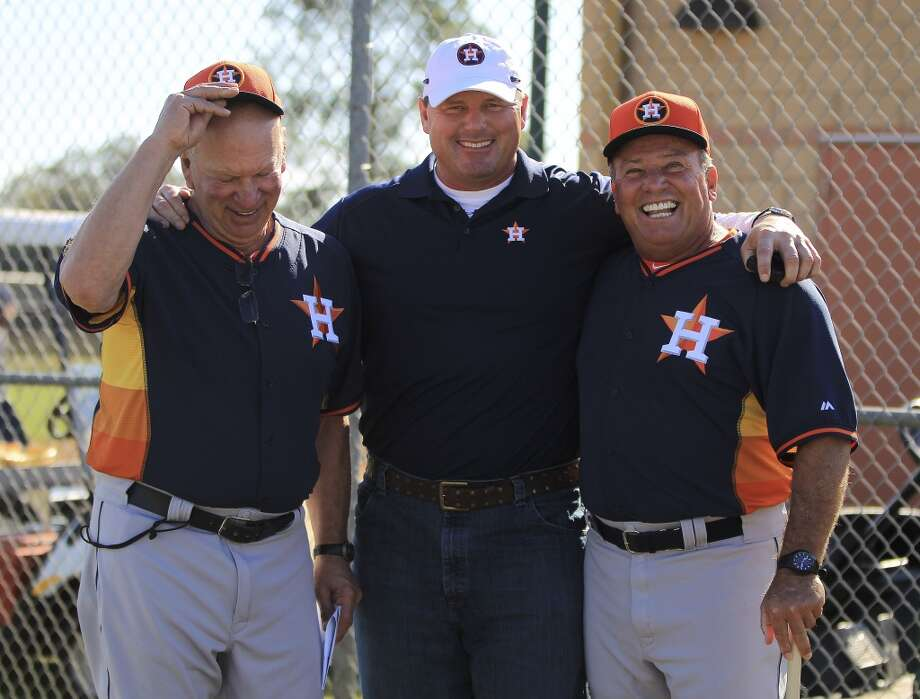 Roger Clemens poses for a photo with Dyer Miller, Astros minor league pitching coordinator and Astros bench coach Dave Trembley during his visit to the pitcher and catcher workouts. Photo: Karen Warren, Houston Chronicle
