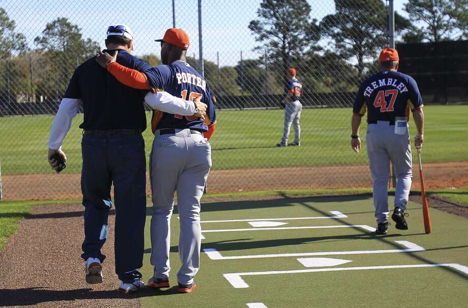 Astros manager Bo Porter and Roger Clemens walk to a side field together during pitcher and catcher workouts. Photo: Karen Warren, Houston Chronicle