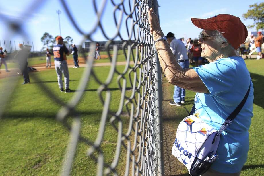 Jan Mingus, of Clear Lake, takes a photo during pitcher and catcher workouts. Photo: Karen Warren, Houston Chronicle
