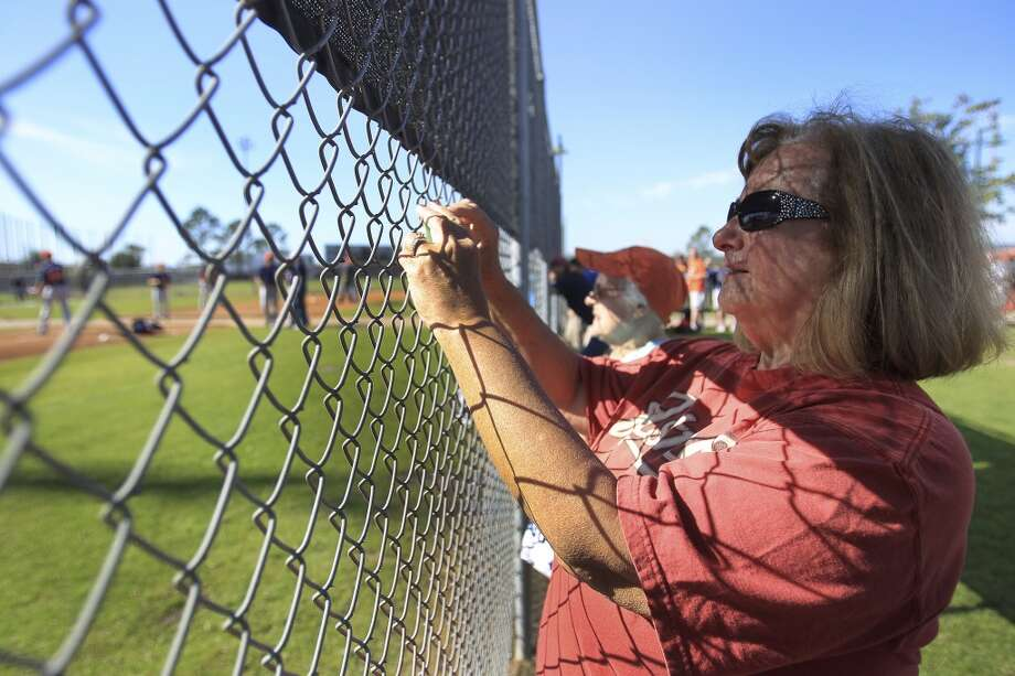 Carole Townsend, of Montgomery, takes a photo during pitcher and catcher workouts. Photo: Karen Warren, Houston Chronicle