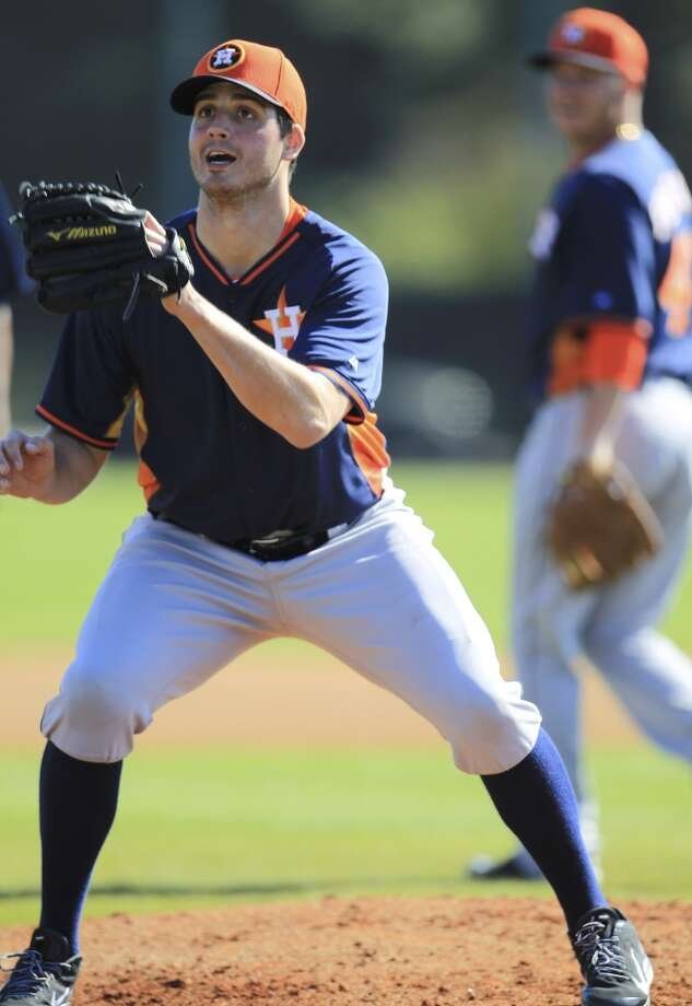 Mark Appel tries to catch a rag ball during drills. Photo: Karen Warren, Houston Chronicle