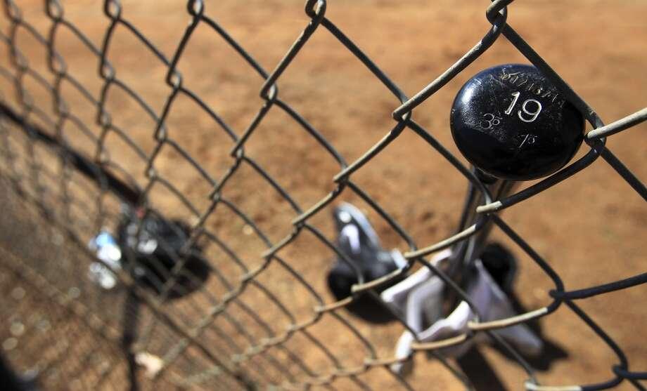 Robbie Grossman's bat leans up against a fence. Photo: Karen Warren, Houston Chronicle