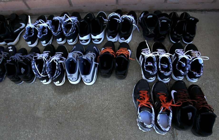 Astros' shoes are lined up outside of the clubhouse after workouts. Photo: Karen Warren, Houston Chronicle