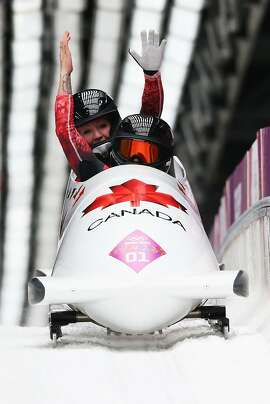 *** BESTPIX *** SOCHI, RUSSIA - FEBRUARY 19:  Kaillie Humphries (front) and Heather Moyse of Canada team 1 celebrate winning the gold medal during the Women's Bobsleigh on Day 12 of the Sochi 2014 Winter Olympics at Sliding Center Sanki on February 19, 2014 in Sochi, Russia.  (Photo by Alex Livesey/Getty Images)