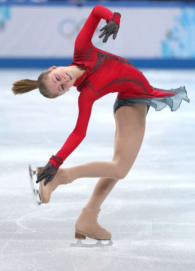 BEST: Red contrasting with the black gloves and black filmy edge to Julia Lipnitskaya's skirt is striking -- and fits the sense of whimsy and impishness you want to see in a 15-year-old.  Here, she skates in the team competition on Feb. 9. Photo: Matthew Stockman, Getty Images