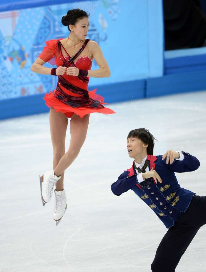 "WORST: China's Qing Pang and China's Tong Jian performed admirably, but their costumes, tied to the ""I Dreamed a Dream"" from Les Miserables, are overly costumey (she looks  more like Xena, Warrior Princess, without a bow and arrow.) Photo: JUNG YEON-JE, AFP/Getty Images"