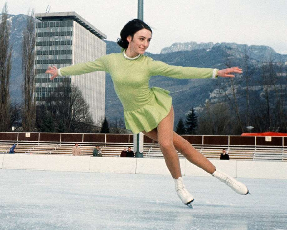 BEST: Bay Area native Peggy Fleming, who won the gold medal at the 1968 Olympics in Grenoble, France, cuts a fine figure in a simple dress with clean lines in a springlike color that contrasts pleasantly with her dark hair. Photo: STAFF, AFP/Getty Images