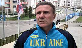 "Ukrainian pole vault great Sergei Bubka is interviewed outside the headquarters hotel of the International Olympic Committee, at the 2014 Winter Olympics, in Sochi Russia on Wednesday, Feb. 19, 2014. Bubka appealed Wednesday to both sides in his homeland's political crisis to halt the violence that has claimed dozens of lives and brought the country ""to the brink of catastrophe.""  (AP Photo/Mark Carlson)"