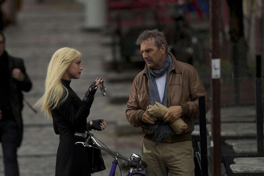 "Agent Vivi Delay (Amber Heard) offers an unusual carrot to keep agent Ethan Renner (Kevin Costner) in play for one more job in ""3 Days to Kill."" Photo: Julian Torres, Relativity Media"