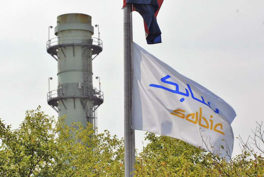 Times Union Staff photograph by Philip Kamrass -- A flag for SABIC Innovative Plastics hangs within sight of a tower from the plant's cogenerating facility, in Selkirk, NY Thursday September 6, 2007. The Saudi company purchased the plant from General Electric recently. FOR LARRY RULISON SUNDAY STORY. Photo: PHILIP KAMRASS / ALBANY TIMES UNION