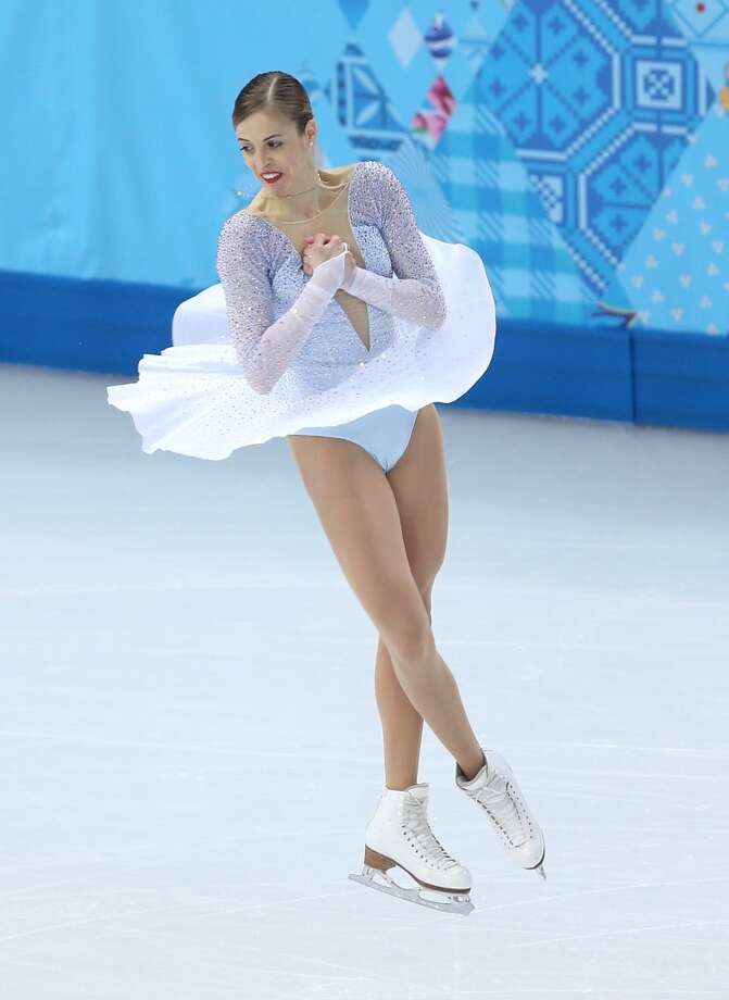 BEST: Ethereal best describes this dress, worn by   Carolina Kostner of Italy, who competed in the team program on Feb. 8.  The skirt is long enough to flow but not overly long and out of proportion, like some other skaters. (Photo by Matthew Stockman/Getty Images) Photo: Matthew Stockman, Getty Images