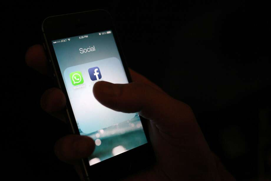 This Wednesday, Feb. 19, 2014 photo, shows the WhatsApp and Facebook app icons on an iPhone in New York. On Wednesday Facebook announced it is buying mobile messaging service WhatsApp for up to $19 billion in cash and stock. (AP Photo/Karly Domb Sadof) Photo: Karly Domb Sadof, Associated Press