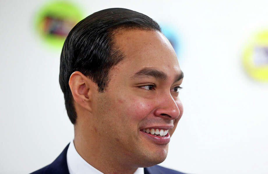 Mayor Julian Castro  sports renewed dark hair as he helps to unveil the  plans for additional educations centers during ceremonies at the Southside Pre-K4 SA center on February 19, 2014. Photo: TOM REEL