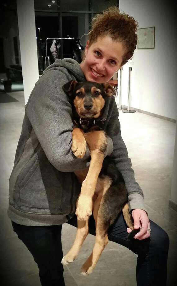 Lindsey Jacobellis is photographed with the stray dog she is bringing home from the Olympics in Sochi. Photo: Contributed Photo / The News-Times Contributed