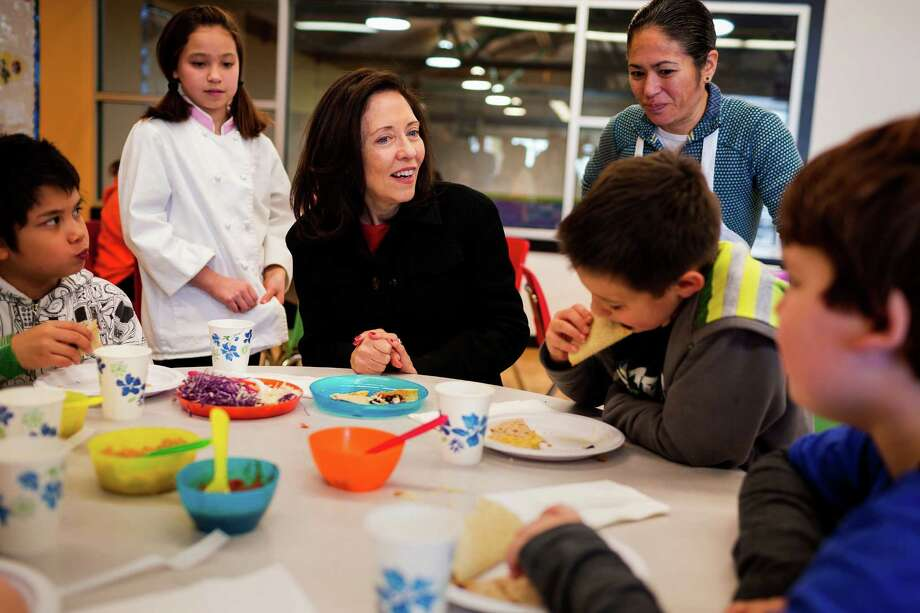 U.S. Senator Maria Cantwell, center, and Seattle-area award-winning chefs, Maria Hines, back right, and 11-year-old Amber Kelley, left, chat with kids at the Wallingford Boys and Girls Club during a demonstration on how to make healthy, kid-friendly meals with lentils and chickpeas Wednesday, Feb. 19, 2014, in Seattle. A newly-passed program in the Farm Bill intends to provide resources for school districts to serve more healthy lunches. The $10 million pilot program Ð modeled after the Whole Grains program Ð will enable schools across the country to test out new recipes and purchase more Washington-grown peas, lentils and chickpeas. Photo: JORDAN STEAD, SEATTLEPI.COM / SEATTLEPI.COM