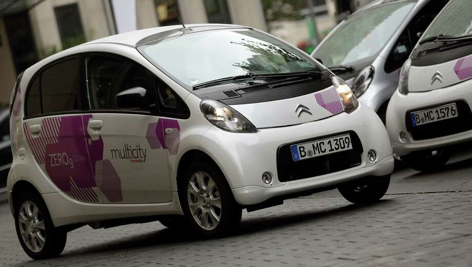 In this photo taken Wednesday, Sept. 5, 2012, Citroen C-Zero electric cars are pictured during the introducing of the 'Citroen Multicity Car Sharing' project in Berlin, Germany. First they ignored it, then they jumped on board. Now some German automakers are switching gears to take car sharing from city streets to the Autobahn, a maneuver that's being closely watched by others who wonder whether it could turn out to be a dead end for the industry. (AP Photo/Michael Sohn) ORG XMIT: WPFJ105 Photo: Michael Sohn / AP