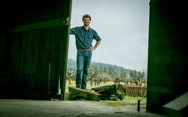 Winemaker Rory Williams in front of old vine Valdiguie vineyard in St. Helena , Calif.,  on February 14th, 2014.
