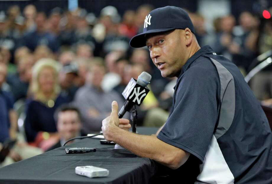 New York Yankees shortstop Derek Jeter gestures during a news conference Wednesday, Feb. 19, 2014, in Tampa, Fla. Jeter has announced he will retire at the end of the 2014 season. (AP Photo/Chris O'Meara)  ORG XMIT: FLCO104 Photo: Chris O'Meara / AP