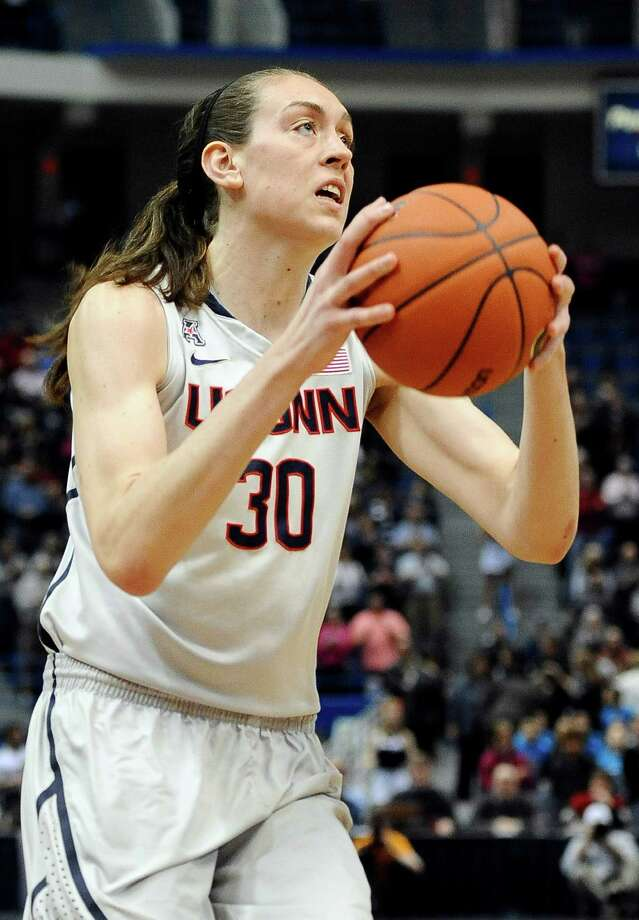 Connecticut's Breanna Stewart goes up for a shot, on which she scored her 1,000th career point at UConn, during the first half of an NCAA college basketball game against Central Florida, Wednesday, Feb. 19, 2014, in Hartford, Conn. (AP Photo/Jessica Hill) Photo: Jessica Hill, Associated Press / Associated Press