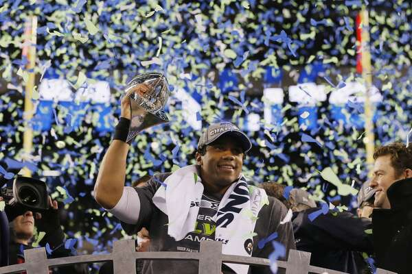 """Who is the best quarterback in Seattle Seahawks history?      Russell Wilson became the first quarterback to win the Super Bowl for the Seattle Seahawks. And he did it in just his second year in the NFL. With defense as Seattle's staple, he led the Seahawks back to the Super Bowl in his third year, but they lost to the New England Patriots. Lately, people have been talking about whether Wilson is an """"elite"""" quarterback and whether he deserves a $20 million-plus paycheck for the coming years. Is he one of the best in franchise history? Take a look at Seattle's most prolific quarterbacks throughout the team's 39-year history."""