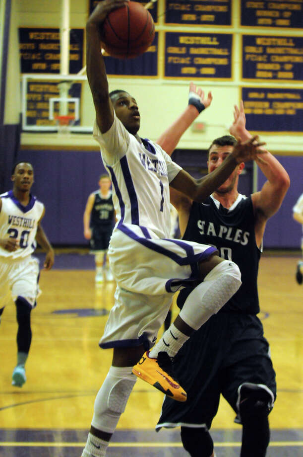 Westhill's Jeremiah Livingston shoots as Staples' Todo Goldstein closes in as Westhill High School hosts Staples in a boys basketball game in Stamford, Conn., Feb. 19, 2014. Photo: Keelin Daly / Stamford Advocate Freelance