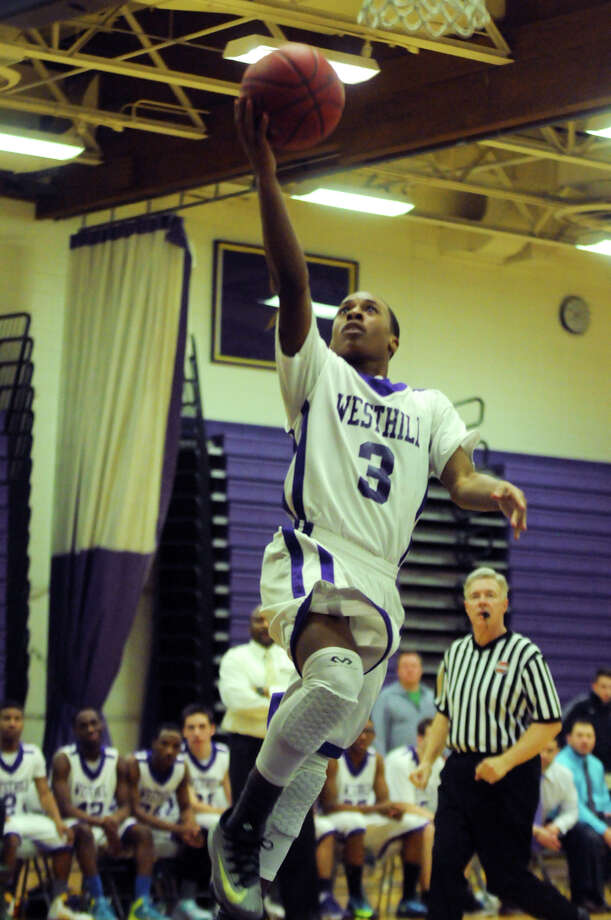 Westhill's CJ Donaldson takes flight as Westhill High School hosts Staples in a boys basketball game in Stamford, Conn., Feb. 19, 2014. Photo: Keelin Daly / Stamford Advocate Freelance