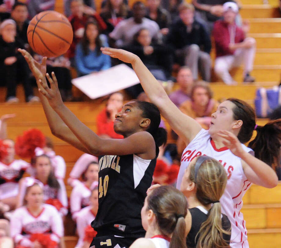 At left, Trumbull's Kalisse Eldridge (#40) attempts a layup while being defended by Jamie Kockenmeister, right, of Greenwich, during the girls high school basketball game between Greenwich High School and Trumbull High School at Greenwich, Wednesday, Feb. 19, 2014. Photo: Bob Luckey / Greenwich Time