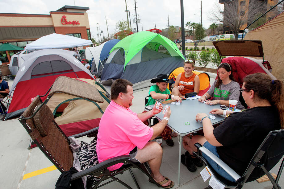 Clockwise from left, Stevin Marsh, Calvin Beauchamp, Amber Bowman, Susan Beauchamp and Melissa Clegg wait for the opening of a Chick-fil-A restaurant on Briar Forest near Eldridge Pkwy S,  Wednesday, Feb. 19, 2014, in Houston. Campers arrived with tents as the first 100 adults in line received a free year's supply of Chick-fil-A meals. The group arrived at 5 a.m. Wednesday morning. Photo: Cody Duty, Houston Chronicle / © 2014 Houston Chronicle