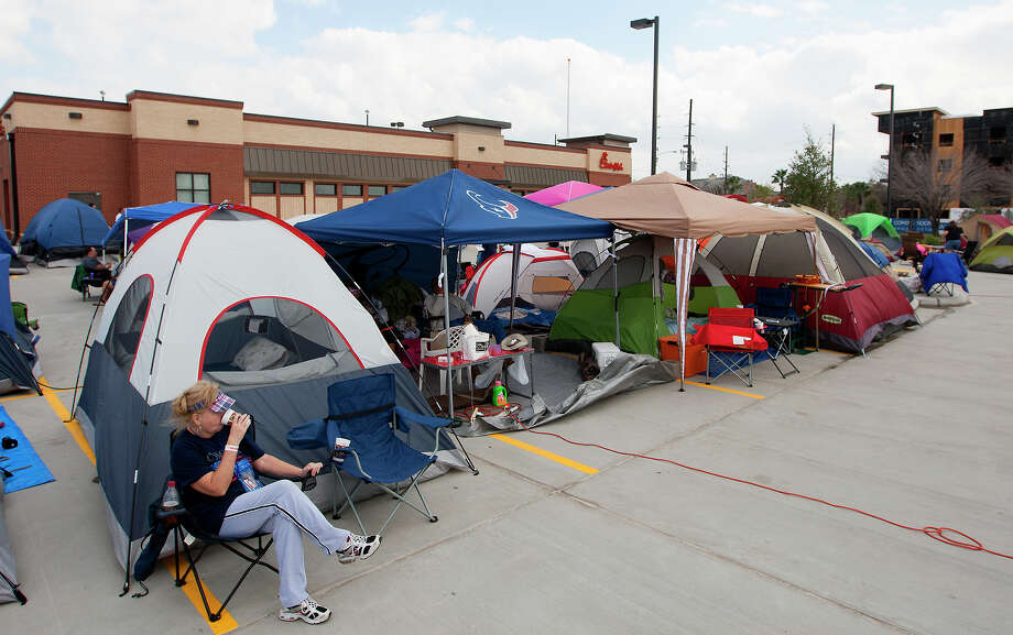 "Sue Bragg waits outside her tent as she waits for the opening of a Chick-fil-A restaurant on Briar Forest near Eldridge Pkwy S,  Wednesday, Feb. 19, 2014, in Houston. Campers arrived with tents as the first 100 adults in line will receive a free year's supply of Chick-fil-A meals. ""It's just fun,"" she said of waiting on the opening. Photo: Cody Duty, Houston Chronicle / © 2014 Houston Chronicle"