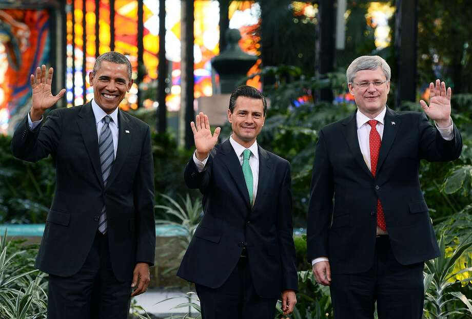 "President Obama (left), Mexican President Enrique Peña Nieto and Canadian Prime Minister Stephen Harper at the North American Leaders' Summit, known as the ""Three Amigos"" meeting. Photo: Jewel Samad, AFP/Getty Images"