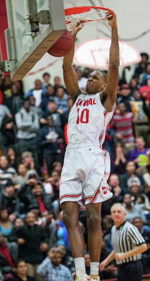 Bridgeport Central high school's Sha'quan Bretoux slam dunks the ball during a boys basketball game against St. Joseph high school played at Bridgeport Central high school, Bridgeport, CT on Wednesday, February, 19th, 2014. Photo: Mark Conrad / Connecticut Post Freelance