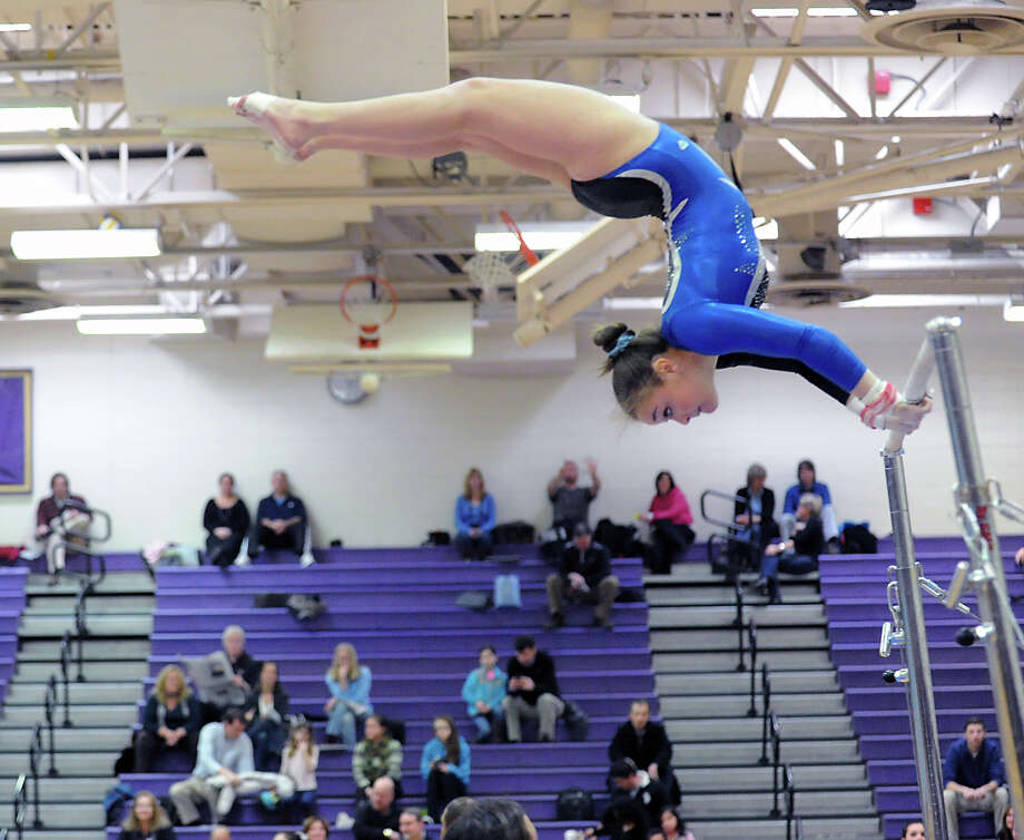 Perry Kindel of Fairfield-Ludlowe High School on the uneven bars during the 2013 FCIAC Girls Gymnastics Championships at Westhill High School in Stamford, Saturday, Feb. 16, 2013. Photo: Bob Luckey / Greenwich Time