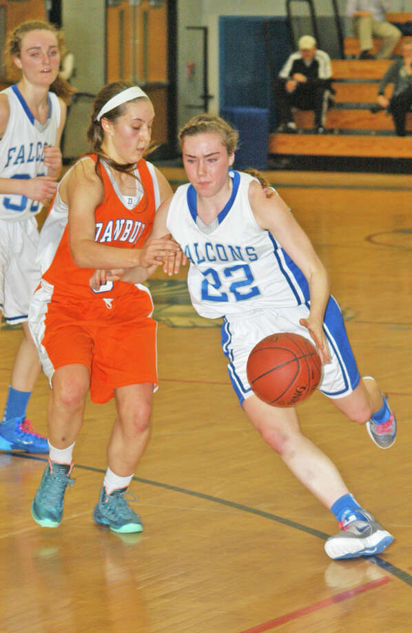 Regan Steed (22), of Fairfield Ludlowe, driving against Danbury on Wednesday, Feb. 19 in an FCIAC girls basketball game in the Falcons' gym. Danbury beat Ludlowe 57-42. The Falcons will play next in the FCIAC quarterfinals on Saturday in Stamford. Photo: Andy Hutchison / Fairfield Citizen