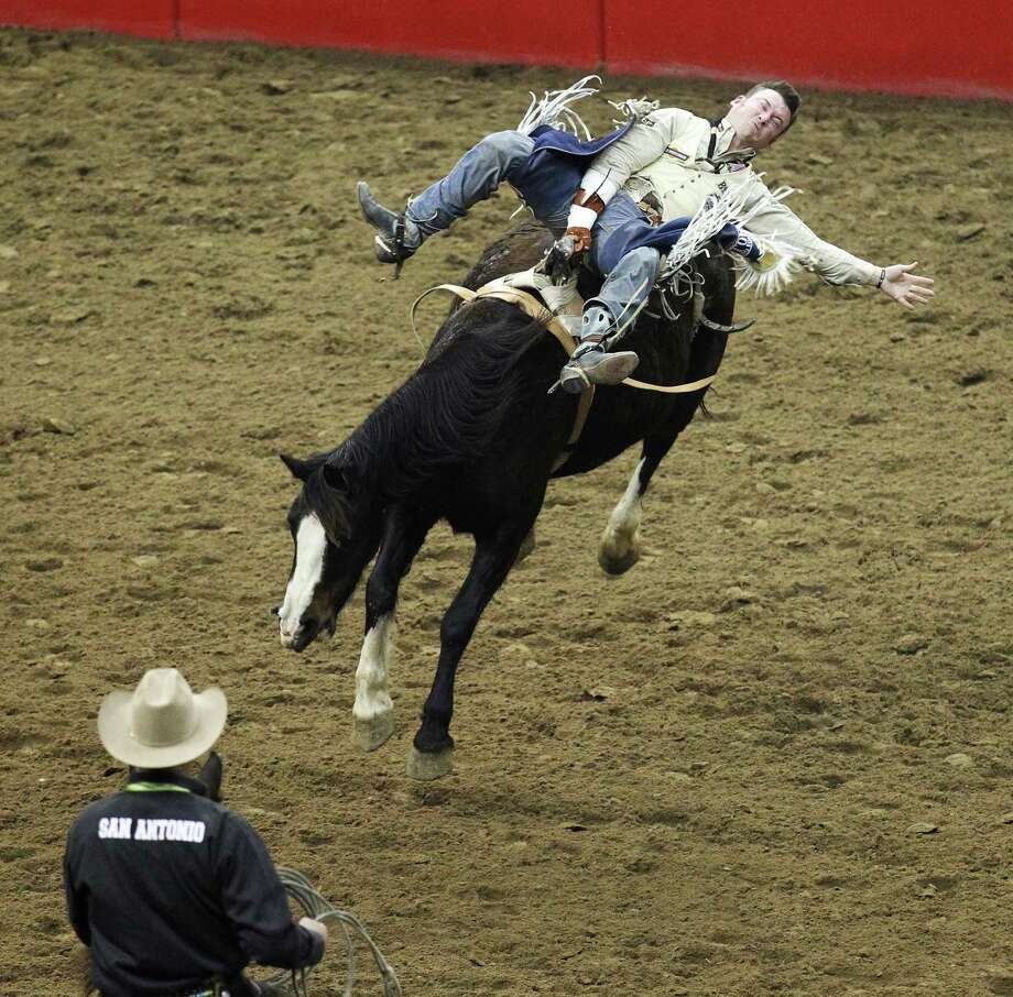 Bareback rider Steven Peebles competes at the 2014 San Antonio Stockshow and Rodeo on Wednesday, Feb. 19, 2014. Peebles scored an 86 to tie for highest score and earned $12,464 so far this season. Photo: Kin Man Hui, San Antonio Express-News / ©2014 San Antonio Express-News