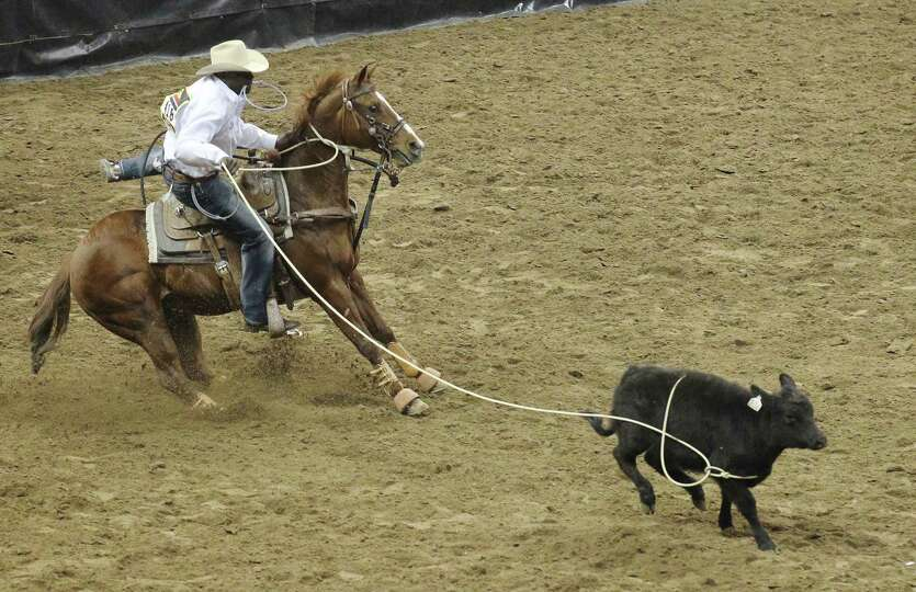 Tie-down roper Fred Whitfield competes at the 2014 San Antonio Stockshow and Rodeo on Wednesday, Feb