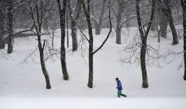 A lone jogger navigates the snowy trail in Washington Park Wednesday afternoon Feb. 19, 2014 during a lengthly snow squall in Albany, N.Y.     (Skip Dickstein / Times Union) Photo: Skip Dickstein