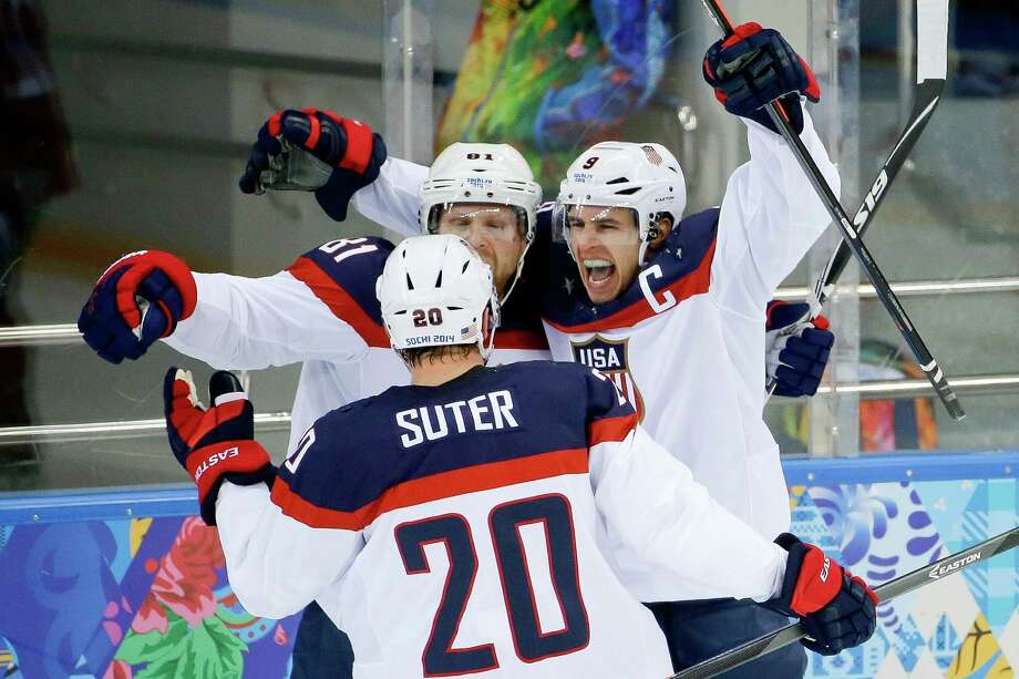 USA forward Zach Parise (9) celebrates his goal against the Czech Republic with teammates Phil Kessel (81) and USA defenseman Ryan Suter during the second period of men's quarterfinal hockey game in Shayba Arena at the 2014 Winter Olympics, Wednesday, Feb. 19, 2014, in Sochi, Russia. (AP Photo/Matt Slocum) ORG XMIT: OLYMH338 Photo: Matt Slocum / AP