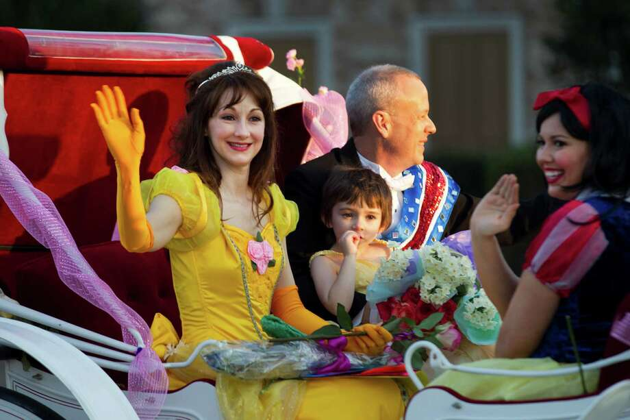 "Loved ones and neighbors came together to help Claire celebrate her ""Princess Day."" Her mom, Trish, turned into a princess, too. The family is shown riding in a horse-drawn carriage. Photo: Brett Coomer, Houston Chronicle / © 2014 Houston Chronicle"