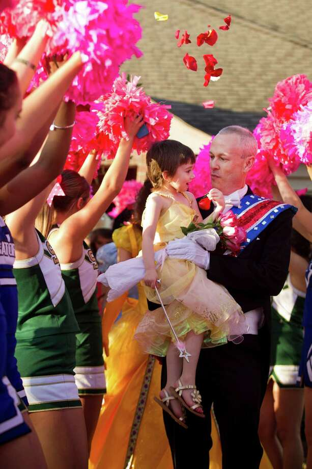 """Claire Lankford was carried by Prince Charming (aka her dad, Kevin) down a red carpet during a surprise """"Princess Day"""" parade for the 5-year-old in  League City on Feb. 19. Claire suffered from alveolar rhabdomyosarcoma, a type of cancer.  Photo: Brett Coomer, Houston Chronicle / © 2014 Houston Chronicle"""