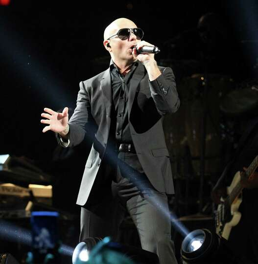 Artist Pitbull performs at the 2014 San Antonio Stockshow and Rodeo on Wednesday, Feb. 19, 2014.