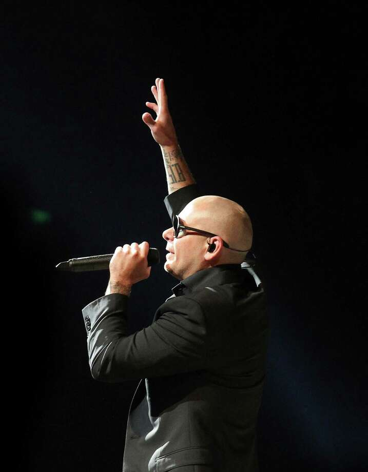 Artist Pitbull performs at the 2014 San Antonio Stockshow and Rodeo on Wednesday, Feb. 19, 2014. Photo: Kin Man Hui, San Antonio Express-News / ©2014 San Antonio Express-News