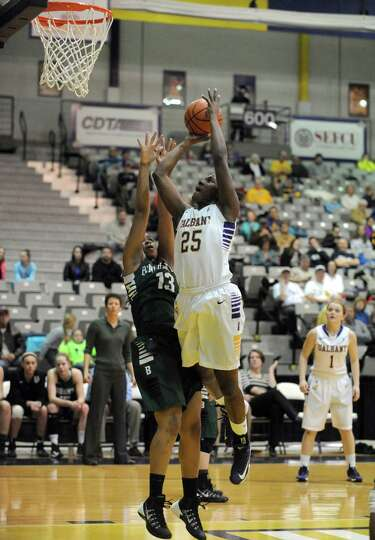 UAlbany's Shereesha Richards goes in for a score during their women's college basketball America Eas