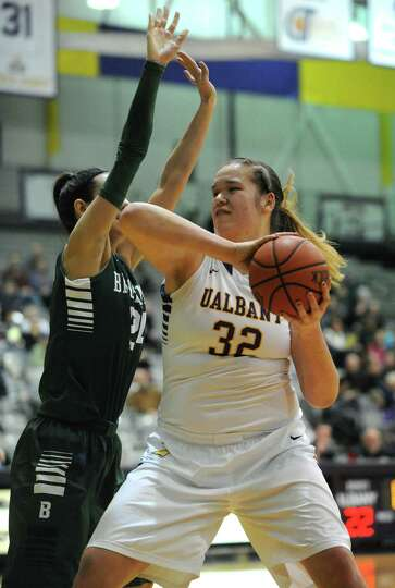 UAlbany's Megan Craig goes to the basket during their women's college basketball America East game a
