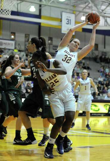 UAlbany's Megan Craig pulls down a rebound during their women's college basketball America East game